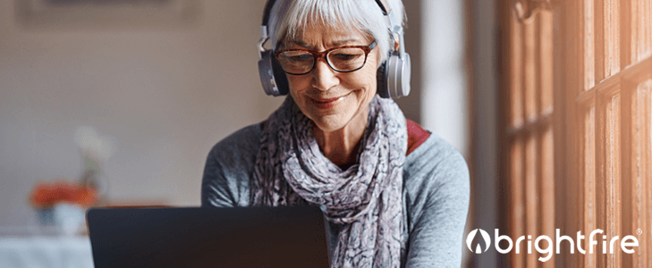 woman using computer with headphones